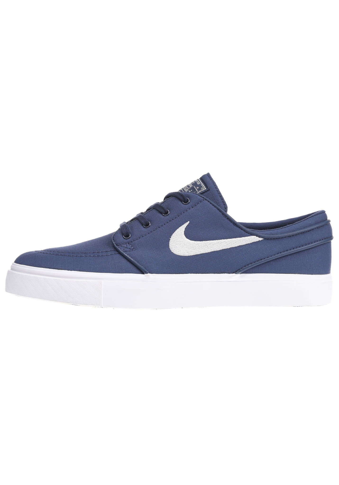 buy popular a71e3 a639c NIKE SB Zoom Stefan Janoski Canvas - Baskets pour Homme - Bleu - Planet  Sports